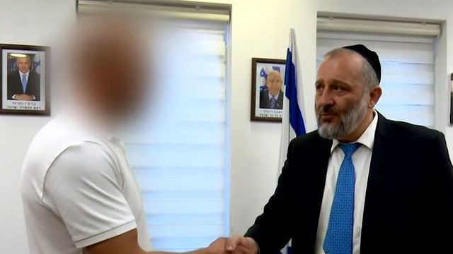 The unidentified Palestinian rescuer and Interior Minister Aryeh Deri