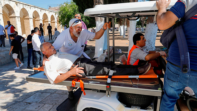 A Muslim worshipper is wounded during clashes with police on Temple Mount, August 11, 2019 (Photo: AFP)