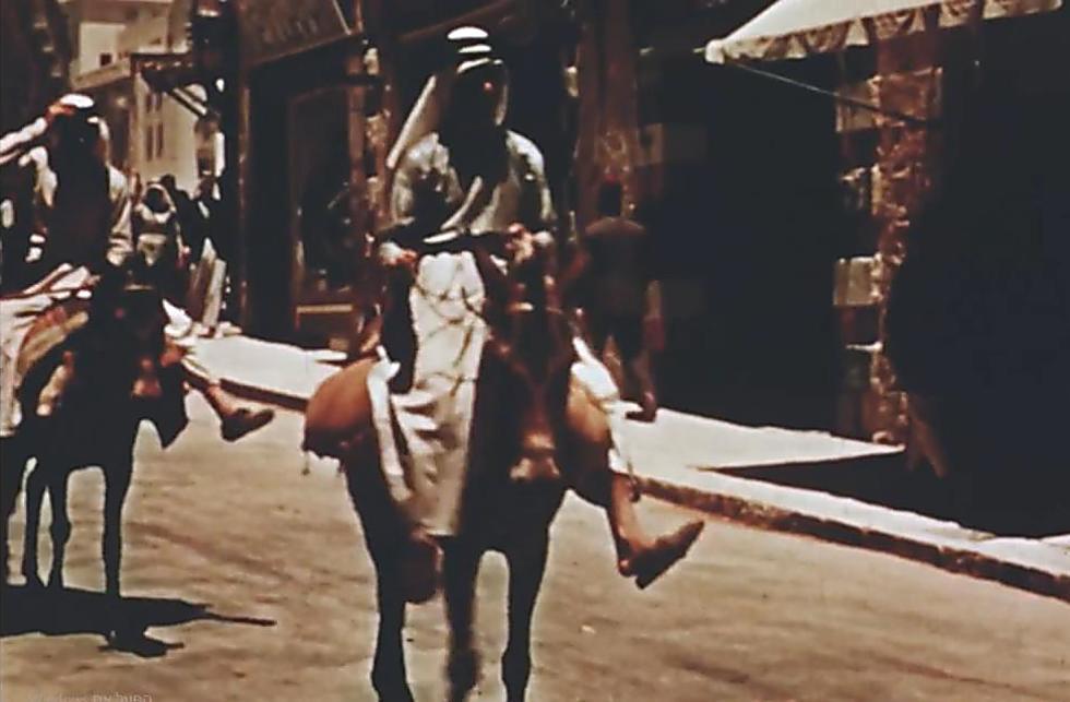 Riding down Jaffa Street (Photo: Jerusalem Cinematheque archive)
