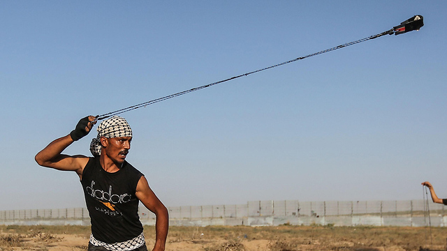 A Palestinian protesting on the Gaza border (Photo: AFP) (Photo: AFP)