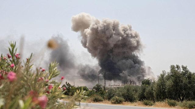 סוריה הפצצה דיר א-שרקי מחוז אידליב אמא ו 7 ילדים נהרגו (צילום: AFP)