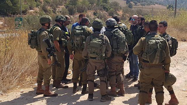Военнослужащие ЦАХАЛа на месте теракта. Фото: Элиша Бен-Кимон