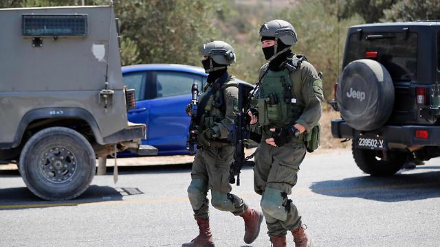 Военнослужащие ЦАХАЛа на месте теракта. Фото: AFP