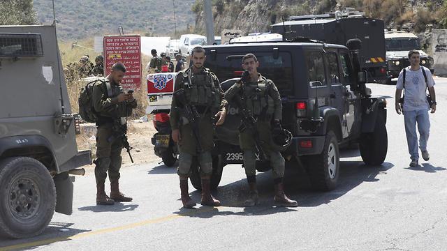 Военнослужащие ЦАХАЛа на месте теракта. Фото: AP
