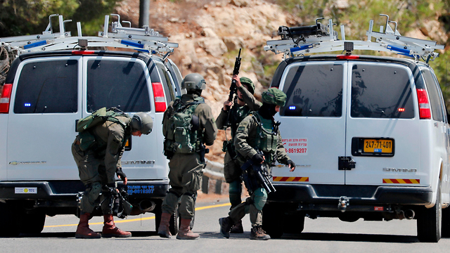 Security forces at the scene of the attack (Photo: AFP)