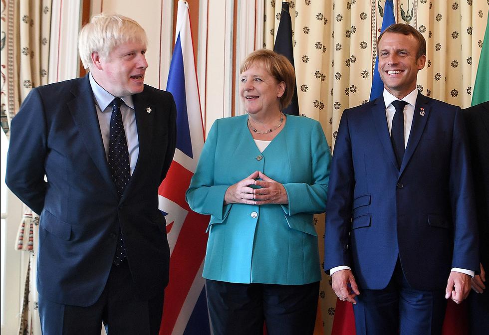בוריס ג'ונסון אנגלה מרקל עמנואל מקרון פסגת G7 ביאריץ צרפת (צילום: gettyimages)