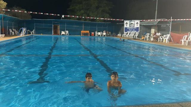 The swimming pool at Netiv Ha'Asara as the sirens sounded