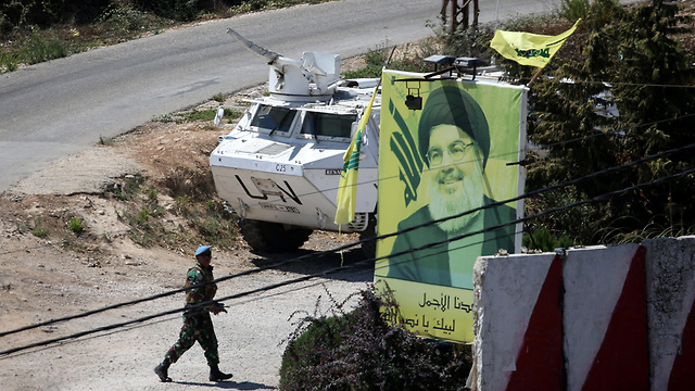UNIFIL forces near a Hezbollah poster along the border (Photo: Reuters)
