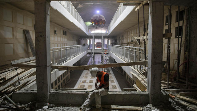 A laborer works at the construction site of a massive underground cemetery in Jerusalem, August 18, 2019