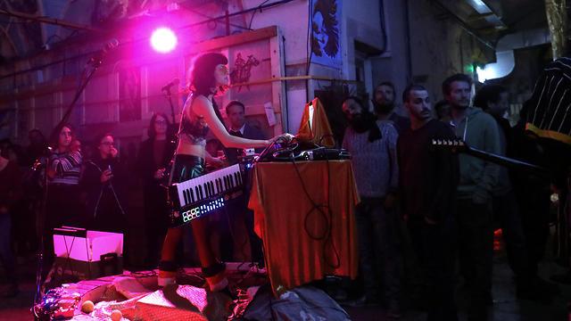 Israeli duo Rimojeki perform at an abandoned building as a public art venue in Jerusalem (Photo: Reuters)