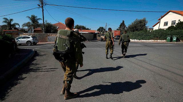 IDF troops at Moshav Avivim (Photo: AFP)
