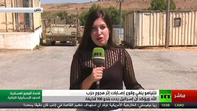 כתבת של RT בערבית מסתובבת ומצלמת בבסיס אביבים ()