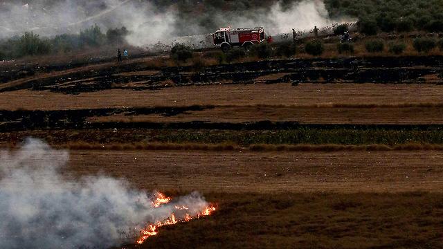 Smoke rises in the Maroun al-Ras area of southern Lebanon after IDF artillery fire  (Photo: AFP)