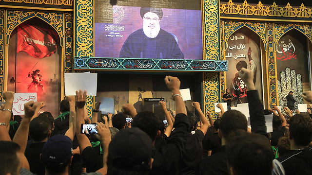 Hezbollah supporters watching Hassan Nasrallah's speech televised from Beirut on Monday (Photo: AFP)