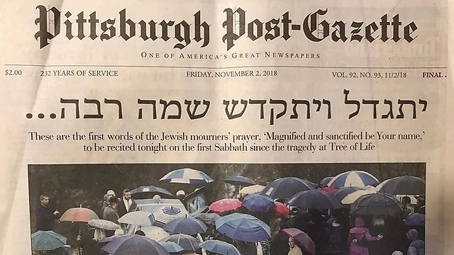 The front page of the local Pittsburgh newspaper carries the Jewish mourners' prayer on the day after the attack