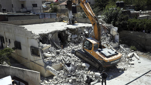 Israeli authorities demolish a Palestinian owned house in east Jerusalem, Wednesday, Aug. 21, 2019