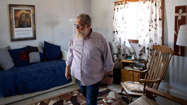 Tommy Waller, founder of U.S.-based Christian group HaYovel, walks inside his family's lodgings at the outskirts of Har Bracha settlement in the West Bank