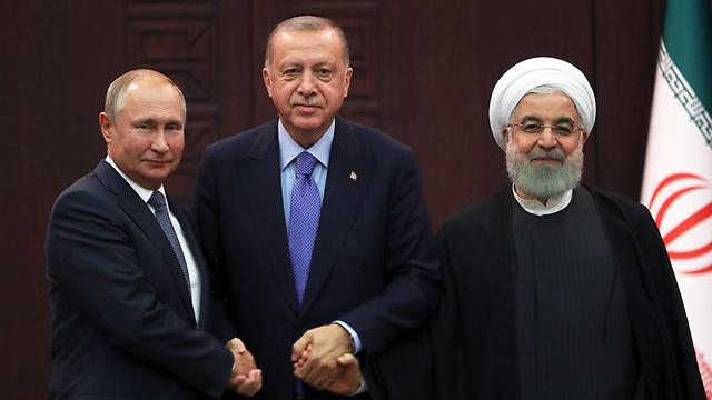 L-R: Vladimir Putin, Recep Tayyip Erdogan and Hassan Rouhani meeting in Ankara (Photo: EPA)