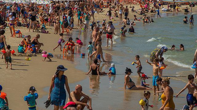 Israelis enjoying the last of the summer on Tel Aviv beach, September 2019 (Photo: Yuval Chen)