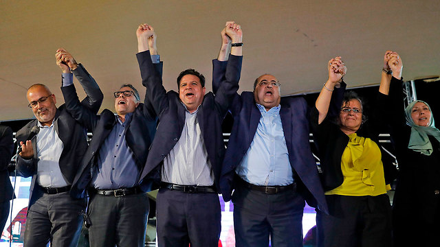 Arab MKs celebrate the Joint List electoral performance after the exit polls were released Tuesday night  (Photo: AFP)