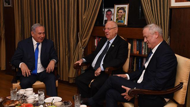 Prime Minister Benjamin Netanyahu (left) President Reuven Rivlin and Blue and White leader Benny Gantz