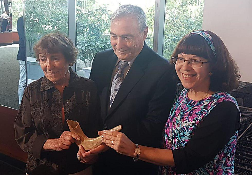 Dr. Judith Baumel-Schwartz, right, holds the shofar with her siblings