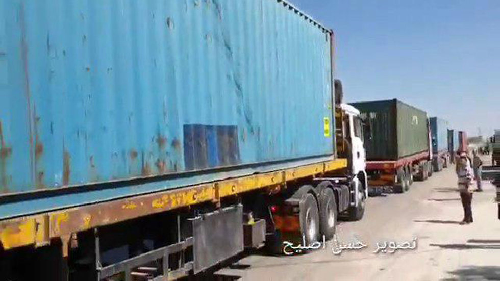 Trucks carrying equipment and medical supplies for a new filed hospital enter the Gaza Strip