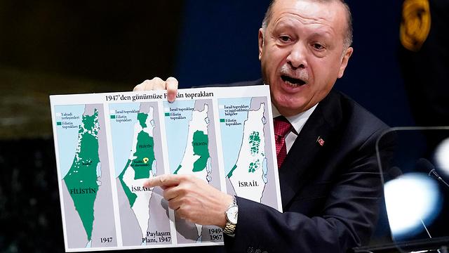 Turkish President Tayyip Erdogan holding map of Israel (Photo: Reuters)