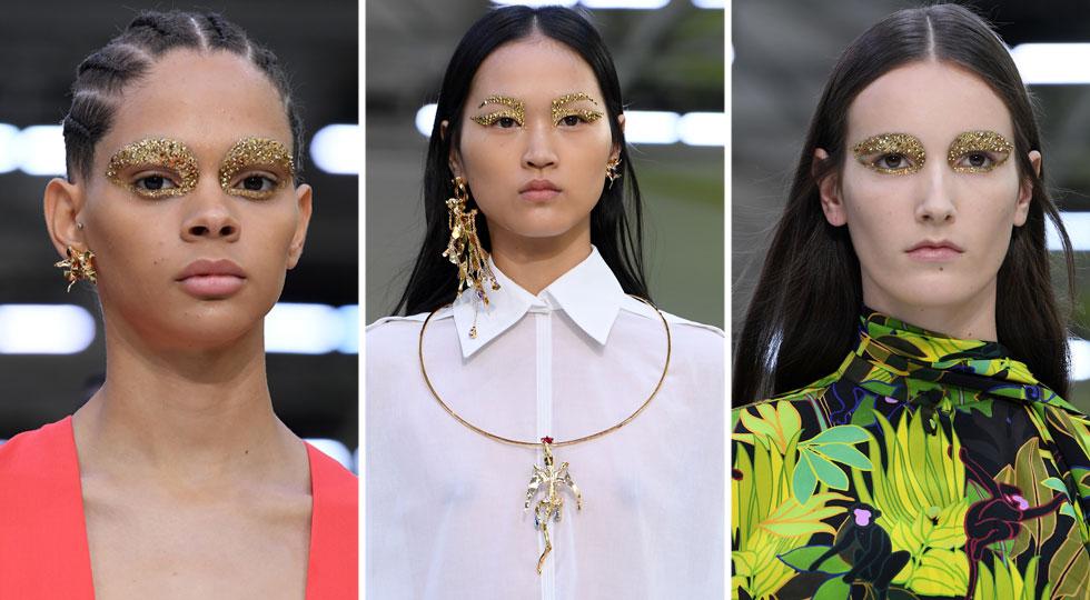 עיני הזהב שהותקנו לדוגמניות בתצוגת האופנה של ולנטינו, עשו לנו חשק לפזר על עצמנו אבק כוכבות. מאפרת העל פט מגרת' יצרה לדוגמניות גבות עשויות צללית זהב בטקסטורה של לורקס, אשר המשיכו גם מתחת לעיניים. יתר איפור הפנים שמר על מראה נקי וטבעי (צילום: Pascal Le Segretain/GettyimagesIL)