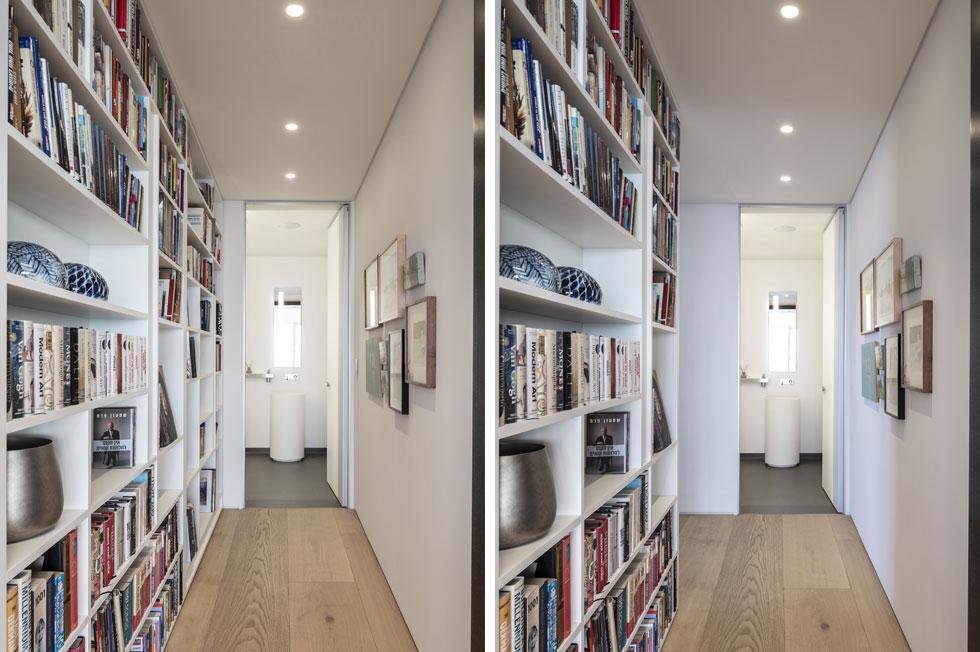 הדלת נפתחת אל מסדרון רחב עם ספרייה לכל אורכו. בסופו שירותי האורחים, וגם חלק נייד של הספרייה הלבנה: הוא יכול להיפתח (כפי שאפשר לראות בתמונה מימין) אל חדר העבודה  (צילום: עמית גרון)