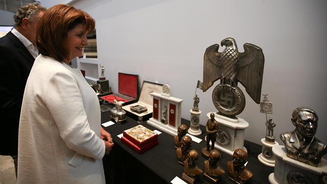 Argentine Security Minister Patricia Bullrich looks at Nazi artefacts before a news conference at the Holocaust museum in Buenos Aires