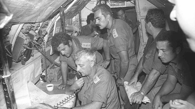 Maj. Gen. Ariel Sharon (holding the radio) during the Yom Kippur War (Photo: IDF Archive)