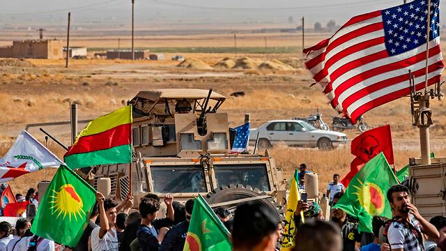 Kurdish fighters alongside U.S. troops in northern Syria (Photo: AFP)