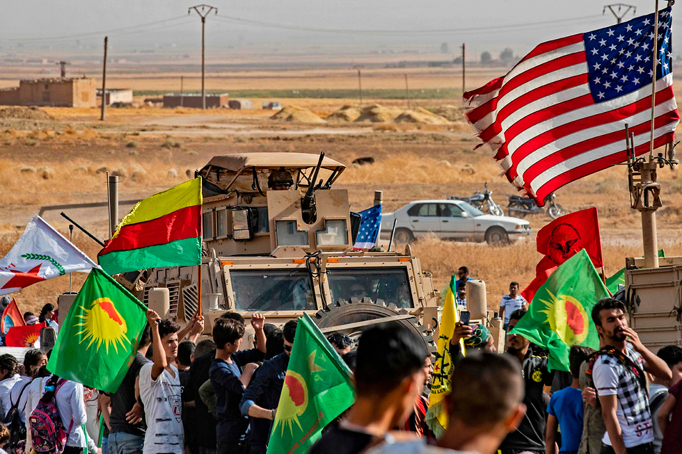 Kurdish fighters and U.S. troops in northern Syria  (Photo: AFP)