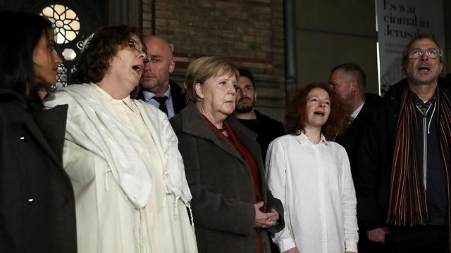 German Chancellor Angela Merkel attending the vigil in Berlin (Photo: Reuters)