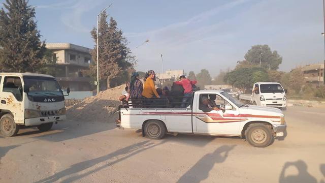 Kurdish civilians flee advancing Turkish forces in northern Syria