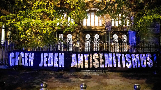A banner reading 'Against all anti-Semitism' is is held up at a solidarity rally in Berlin after the attack on a synagogue in Halle, Oct. 9, 2019