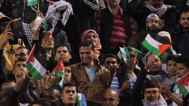 Palestinian soccer fans attend a November 2015 World Cup qualifier against Saudi Arabia in Amman, Jordan