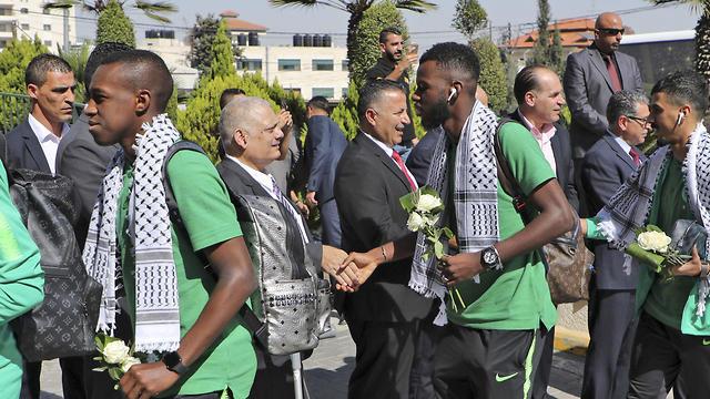 Members of the Palestine Football Federation welcome Saudi Arabia's national football team in Ramallah, Oct. 13, 2019