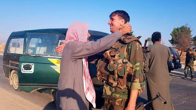 כורדים צפון סוריה חיילי צבא אסד בעיר תל תמר (צילום: AP ,SANA )