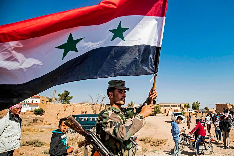 כורדים צפון סוריה חיילי צבא אסד בעיר תל תמר (צילום: AFP)
