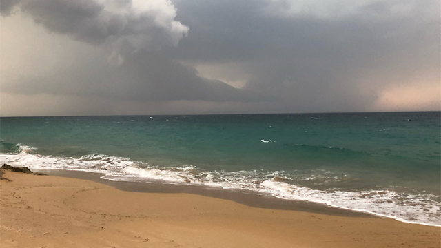 Stormclouds gather over Betzet beach in northern Israel (Photo: Oded Marcus)