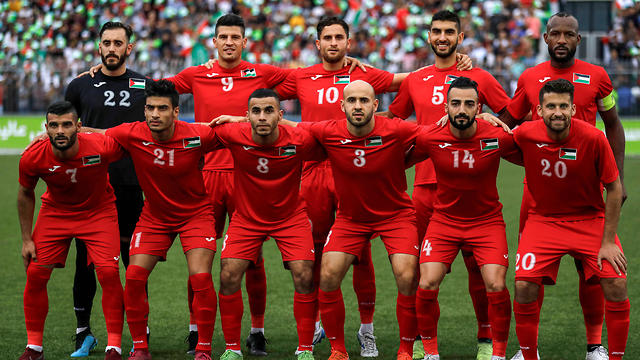 Palestine's starting eleven pose for a group picture before the World Cup 2022 qualifying match against Saudi Arabia in the West Bank, Oct. 15, 2019