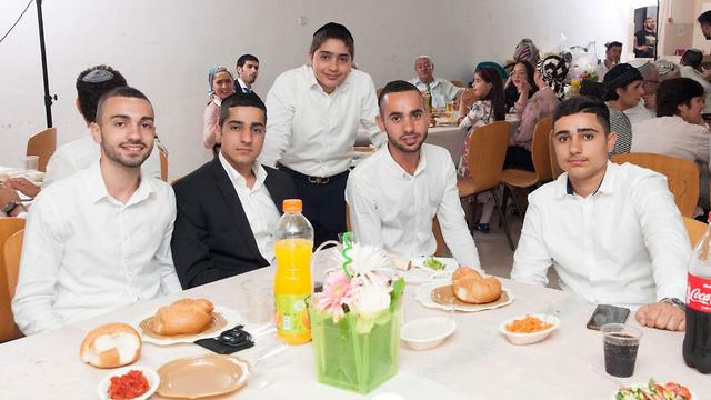 Asher Hazut, center, with family members