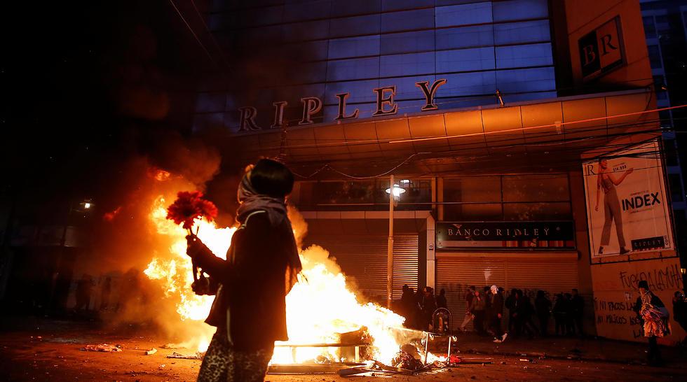 מהומות בעיר ולפראיסו, צ'ילה (צילום: רויטרס)