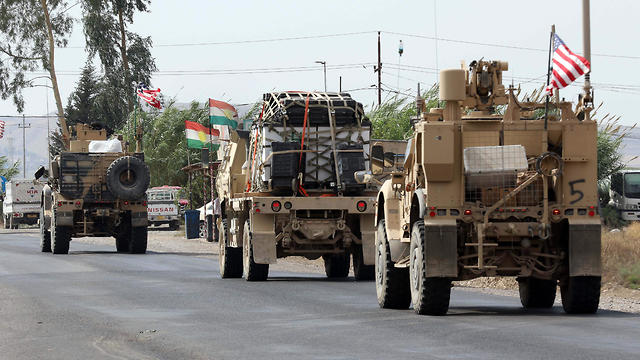 A convoy of U.S. military vehicles arrives near the Iraqi Kurdish town of Bardarash in the Dohuk governorate after withdrawing from northern Syria, Oct. 21, 2019