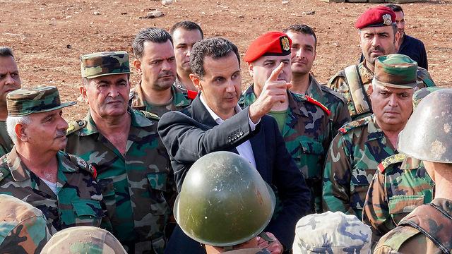 בשאר אסד ביקור ב אידליב סוריה (צילום: AFP)