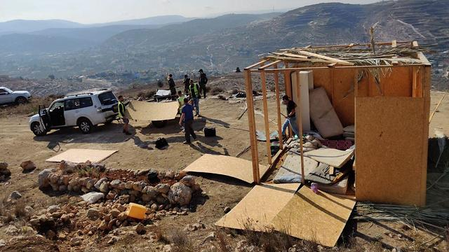 Wooden structures razed by Israeli security forces