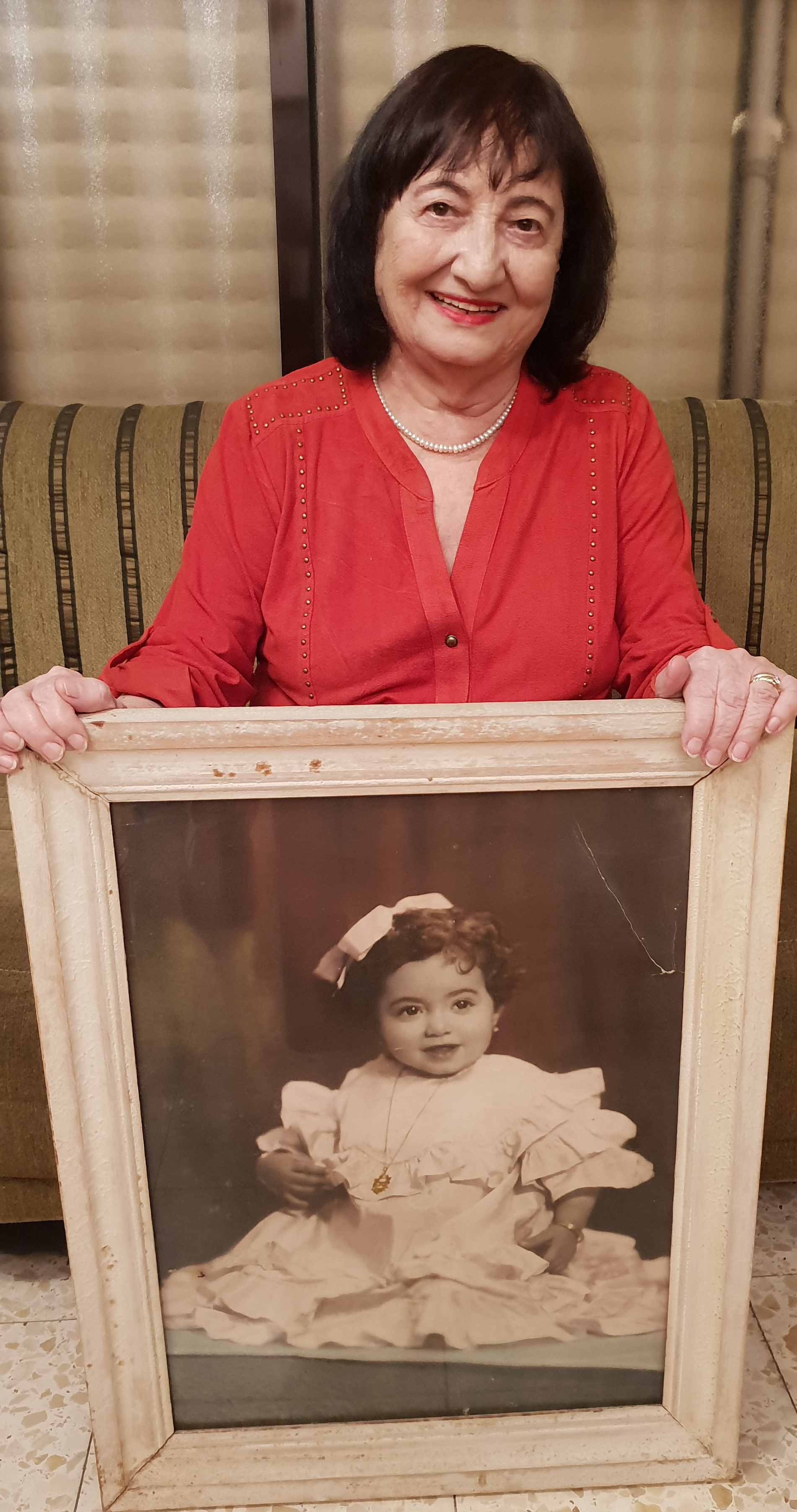 Eva Gabay with her baby picture (Photo: Ilan Gabay)