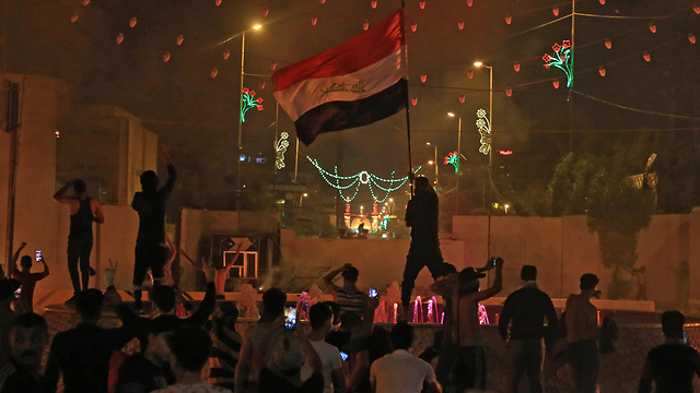 A nightly protest in Baghdad  (Photo: AFP)